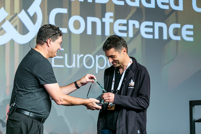 Michael Opdenacker receives an award at the Embedded Linux Conference Europe